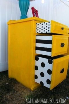 Awesome dresser makeover with stenciled drawer sides for a punch