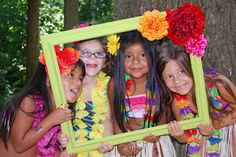 Photo booth-  Big frame, over sized glasses, flowers, leis, beach hats, tiki masks, umbrellas, surf boards, palm trees...