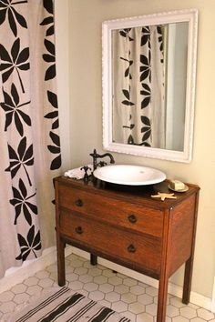 Shower curtain, chest of drawers used as sink, floors