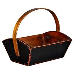 Trough-style wood bucket in black with a curved top handle.   Product: BucketConstruction Material: WoodColor: Black  Features:  Curved top handle Dimensions: 15 H x 23 W x 14 D