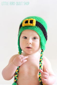 'Little Leprechaun'  This doesn't link to a free pattern, but you could make this from any flap hat pattern. Alternate green and black for the hat, crochet the buckle separately and sew it in with matching yarn. Tie on yarn strings and braid them. You could even make the top part without flaps from a simple hat pattern.