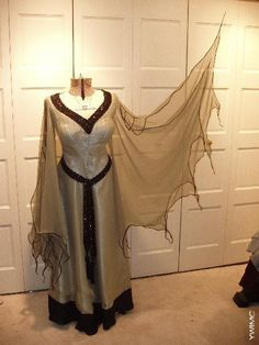 Lily Munster dress. I'd love to recreate this somehow though I have very little sewing skills