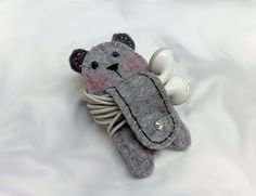 You can keep your earphones cable neat and tangle free.     You just wind around the stomach of this medium size bear and secure it with a button as s
