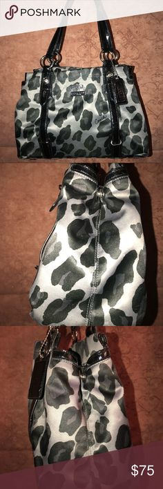 Authentic Coach black and grey leopard purse. Black and gray leopard purse, Authentic Coach purse with purple lining. I'm good condition, no rips or tears. Lining on the inside is a beautiful purple does has some dirty spots from makeup/dirt/dust. Coach Bags Totes