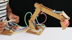 How to Make Hydraulic JCB From Cardboard In this video I show you how to make Hydraulic JCB from cardboard, it's quite fun to play with. Science Exhibition Projects, Science Projects For Kids, Stem Projects, Science For Kids, School Projects, Diy Crafts For Kids, Diy Hydraulic Toys, Hydraulic Excavator, Science Fair
