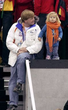 Willem-Alexander with Amalia (wearing a scarf way too big for her) cheering on the Dutch team