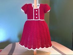 This great video tutorial, on YouTube, teaches you how to crochet this red Christmas/Holiday dress for your little baby.  Super cute!