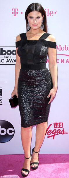 Red carpet style: Songstress Idina Menzel opted for a stylish little black dress...