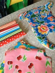 Tips voor het naaien van zeil: tape onder voetje, ledernaald, grote steek en vasthouden met paperclip
