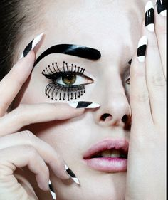 Dramatic black and white nals with doll makeup