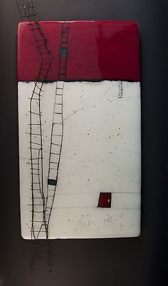 .white red and black ceramic but it looks like encaustic