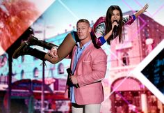 Victoria Justice Photos - Co-hosts John Cena (L) and Victoria Justice speak onstage during Teen Choice Awards 2016 at The Forum on July…