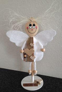 Ange gardien, avec une spatule en bois www.pinterest.com/fleurysylvie
