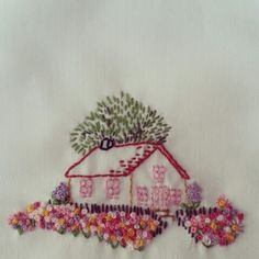 Embroidery - love the flowers and tree in the background