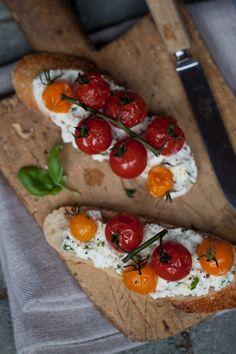 Tomato + goat cheese crostini