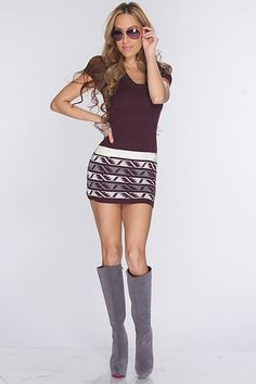 With winter on its way stay warm and add this stylish sweater dress to your collection. Pair it with your favorite thigh high boots and accessories for a complete look! This must have dress features ribbed scoop neckline, short sleeves, knitted pattern, buttoned straps, and fitted. 100% Acrylic. Made in USA.