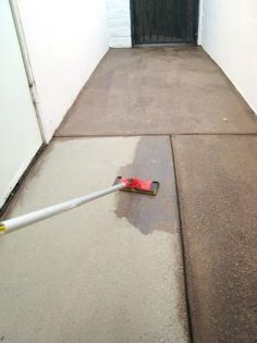 Begin applying the stain over the rest of the concrete with the pad. Use the seams as natural divisions to work in. Stay in only one section at a time so you can maintain control over blending without it drying too quickly.