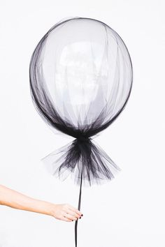 Clear balloons and a swath of tulle make for sophisticated (and dead simple) Halloween decorations.