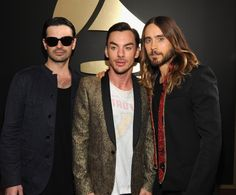 Tomo Milicevic, Shannon Leto and Jared Leto of Thirty Seconds To Mars arrive at the 56th Annual GRAMMY Awards on Jan. 26 in Los Angeles
