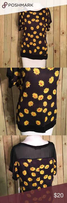 black Daisy Blouse BLack daisy Blouse with mesh back! Perfect for spring and summer. Tops Blouses