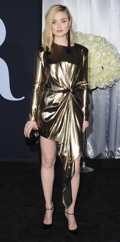 Bella Heathcote exuded glam through and through at the Fifty Shades Darker premiere, in which she wore a gold metallic lame Saint Laurent dress, complete with a black oval clutch and ankle-strap pumps, both by YSL.