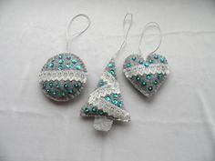 These are beautifully handmade Christmas decorations. It includes 1 Christmas tree, 1 heart and 1 ball. They are ideal for your Christmas tree, as a wall hanging, or just to hang on a door handle to add that extra little touch of homemade goodness. Exclusively hand-cut, hand-sewn and hand embroidered, filled with polyester filling. Decorated with lace, sequins and beads party only one side.