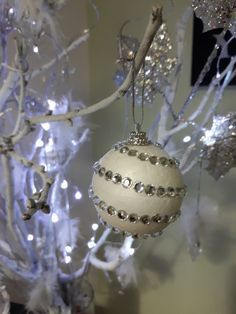 DIY Christmas tree ornament from styrofoam ball and decorated with crystal stickers.