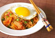 Kimchi Fried Rice with Bacon and Egg - Ever wonder how Koreans stay so slim? According to Health.com, obesity is not common in Korea due to the fact that Koreans eat a lot of Kimchi.      But just what is Kimchi? Kimchi is spicy fermented cabbages, sort of like the Asian version of Sauerkraut.