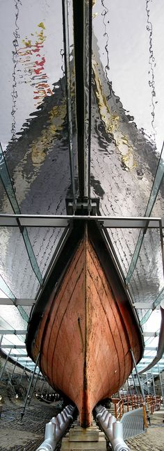 Unusual stitched panoramic view of the SS Great Britain crying out to be vectorised. Photo by Nicholas van der Walle using an old digital camera and Photoshop. The view is a stitch of photos from straight-on level to vertically above view point (prow of the ship). The SS Great Britain is back in its original Bristol dry dock where Mr Brunel oversaw its original build - a wonderful installation with a thin surface of water on glass resulting in the wonderful effect.