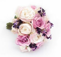 Large posy of roses and lilac.