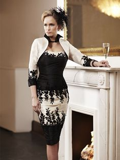This fabulous Ian Stuart London dress has been beautifully designed with a floral lace embellishment across the fabric in a black/platinum shade of colour. Paired with a matching bolero. Product code ISL417.  View more Mother of the Bride / Groom dresses from our Ian Stuart collection at: http://www.baroqueboutique.co.uk/mother-of-the-bride-south-wales/   Photographs courtesy of:  http://www.ianstuart-london.com/