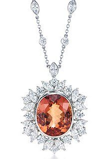 Tiffany's Cushion-cut imperial topaz, 24.79 carats; round brilliant and marquise-cut diamonds, carat total weight 8.06, color grade G, clariy grade VS; platinum