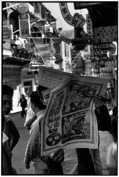 Henri Cartier-Bresson - HONG KONG. 1949. The Chinese traders newspaper of Hong Kong published a special edition with two new announcements. All of southern China was from then on under the control of the People's Army.