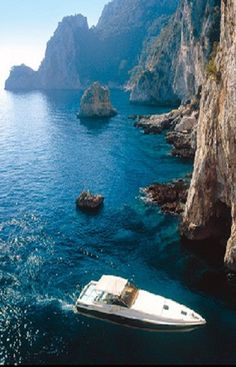 a private boat ride in the blue sea is an afternoon well spent. (capri) #travelcolorfully