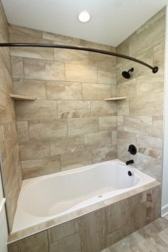 "Combo Shower with Bubble Style Tub.   I would install a Jetted Style tub vs ""bubble"".  This is a great option when you have a small space and want both a shower and Jetted Tub.  Rylee #2 - Spaces - Other Metro - Dreamscape Homebuilders"