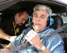 TV host Jay Leno prepares to drive the pace car around the track after the NASCAR Busch Series Hershey's Kissables 300 race at Daytona International Speedway on February 18, 2006 in Daytona Beach, Florida.