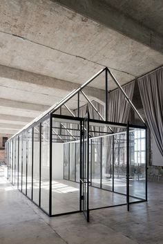 A greenhouse acts as a flexible meeting space at DI Telegraph coworking space in Moscow, Russia. Design by Archiproba.