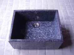 Natural stone kitchen sink. In Blue pearl granite. Fits standard opening. Available in marble and other granites.