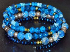 Peacock blue turquoise bracelet.  Beautifully done.  listing at https://www.etsy.com/listing/234509822/blue-beaded-memory-wire-bracelet-blue
