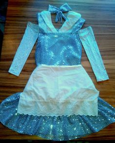 """Want to run your next Disney race as """"Beauty and The Beast"""" Belle in her blue dress? This tutorial will show you how to made a simple Belle running costume."""