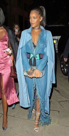 While out in London with Drake, Rihanna steps out in a monochromatic Balmain outfit.