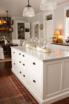 for the love of a house: kitchen drawers.  Organization to the hilt!  Drawers make much more sense than those cabinet doors that you have to stand on your head to access!