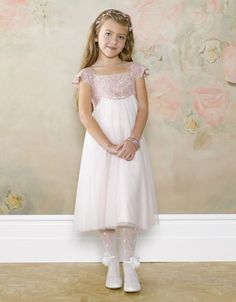 This is pale pink version.  J has the gold accent version.  not sure of tights and shoes...