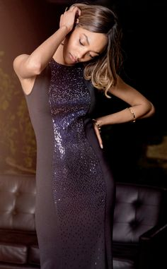 Own the night down to the last sparkling detail in this navy sequin gown. #StJohnKnits