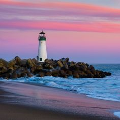 Large Solid-Faced Canvas Print Wall Art Print entitled Santa Cruz Breakwater Lighthouse in Santa Cruz, California at sunset