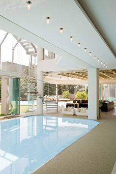 The guys over at Nico van der Meulen Architects made this 4000 sq. m behemoth of a house. An indoor pool area complete with a bar and seating area is Popsugar, Glass House, Pool Designs, My Dream Home, Dream Homes, Dream Life, Lounge, Home Projects, Design Projects