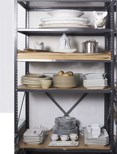 """Part of why I like organization is that it fits into my aesthetic, which is industrial and repetitive,"" says NY designer Peri Wolfman, whose kitchen closet is one of the many spaces in her home that's more functional than fancy."