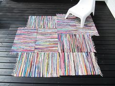 from Bambula!: make a larger area rug out of smaller colorful rugs - should be much more affordable!