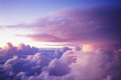 Sunset clouds viewed from the window of a commercial airplane.