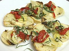 Get this all-star, easy-to-follow Artichoke Toasts recipe from Rachael Ray's Tasty Travels